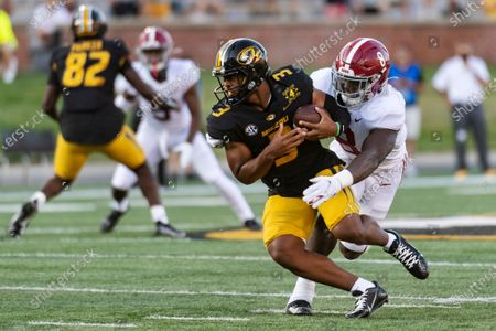 Stock Picture of Missouri starting quarterback Shawn Robinson, left, is sacked by Alabama's Christian Harris, right, during the first quarter of an NCAA college football game, in Columbia, Mo