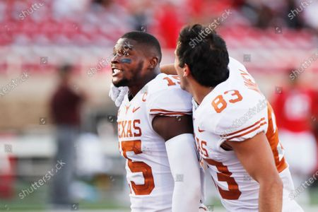 Texas defensive back Chris Brown and wide receiver Kai Money celebrate their win over Texas Tech after an NCAA college football game against Texas Tech, in Lubbock, Texas