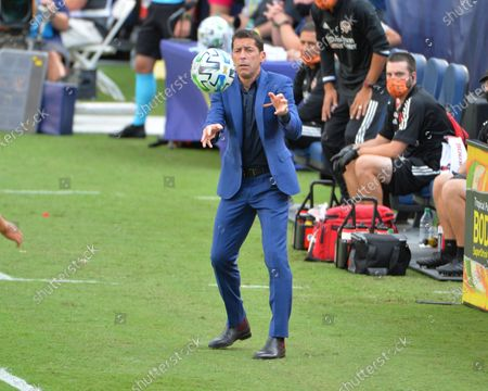Houston Head Coach, Tab Ramos, throws the ball in on the sidelines during the MLS match between the Houston Dynamo and Nashville SC at Nissan Stadium in Nashville, TN