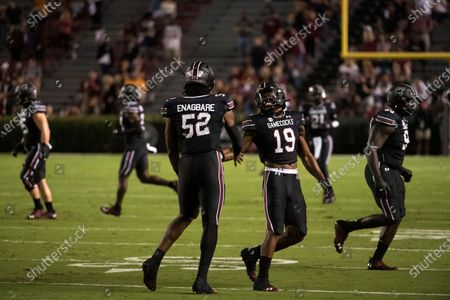 South Carolina defensive lineman Kingsley Enagbare (52) and Brad Johnson (19) celebrate a defensive stop during the first half of an NCAA college football game, in Columbia, S.C. Tennessee defeated South Carolina 31-27