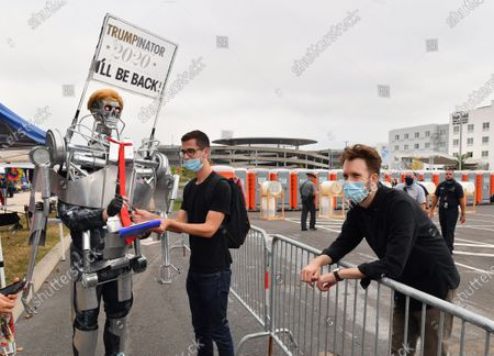 Comedian and Daily Show contributor, Jordan Klepper (R) and a Donald J. Trump supporter dressed in Terminator cosplay at a campaign rally