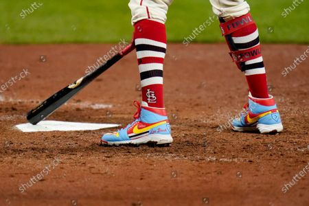 Stock Photo of St. Louis Cardinals' Dexter Fowler taps the plate as he prepares to bat while wearing cleats honoring former Cardinals great Lou Brock during the eighth inning of a baseball game against the Milwaukee Brewers, in St. Louis. Brock died recently at the age of 81