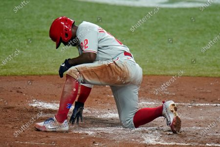 Philadelphia Phillies' Andrew McCutchen (22) reacts after getting tagged out at home plate by Tampa Bay Rays catcher Mike Zunino (10) while trying to score on a single by J.T. Realmuto during the second inning of a baseball game, in St. Petersburg, Fla