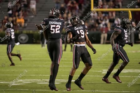 South Carolina linebacker Brad Johnson (19) and defensive lineman Kingsley Enagbare (52) celebrate a stop against Tennessee during the first half of an NCAA college football game, in Columbia, S.C