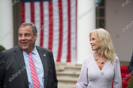Former New Jersey Governor Chris Christie (R), left, and Kellyanne Conway, right, chat with other guests following President Donald Trump's announcement of Amy Coney Barrett, 48, as his nominee for Associate Justice of the Supreme Court of the United States during a ceremony in the Rose Garden at The White House in Washington, DC., Saturday, September 26, 2020.