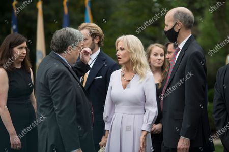 Kellyanne Conway, right, chats with US Attorney General William Barr, left, following President Donald Trump's announcement of Amy Coney Barrett, 48, as his nominee for Associate Justice of the Supreme Court of the United States during a ceremony in the Rose Garden at The White House in Washington, DC., Saturday, September 26, 2020.