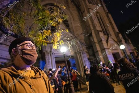 Reverend Tim and protesters gather outside of the Calvary Episcopal Church  during the demonstration.Protesters assembled in Louisville to protest against the Grand Jury decision to only indict one of the three Louisville Metro Police Officers who were involved in the killing of Breonna Taylor with first degree wanton endangerment charges. Protesters hoped all three police officers would be indicted for killing Breonna Taylor, but the decision from the grand jury does not address Taylor's killing with the indictment. The decision from the grand jury has created unrest within Louisville and across the nation. Jefferson Park has acted as a starting point for many of the protests, and the protesters assembled at the park around 5pm moving through the Eastern Market District, into the Bourbon District before coming back to Jefferson Park around 7:30pm. Protesters were confronted by lines of Louisville Metro Police in riot gear blocking their western trajectory on East Main St. into Downtown. LMPD used flash bangs to disperse the crowd, and corral the protesters onto East Market St. After reassembling at Jefferson Park the protesters marched to the First Unitarian Church of Louisville to take refuge for the night. At the church protesters were provoked by a resident throwing objects from a nearby high rise building. LMPD responded to the incident, and all parties were able to deescalate the situation.