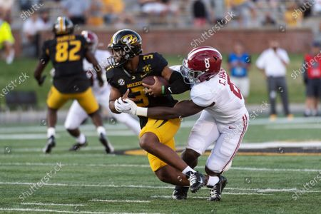 Stock Photo of Missouri starting quarterback Shawn Robinson, left, is sacked by Alabama's Christian Harris, right, during the first quarter of an NCAA college football game, in Columbia, Mo