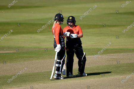 Emily Windsor (left) and Charlotte Taylor of Southern Vipers meet between overs