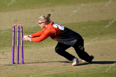 Charlie Dean of Southern Vipers breaks the stumps to run out Ami Campbell