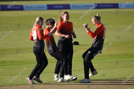 Georgia Adams (right), Tara Norris, Paige Scholfield and Alice Monaghan of Southern Vipers celebrate the final wicket to win the Rachael Heyhoe Flint Trophy