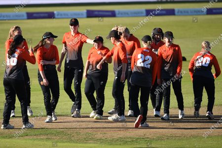 Stock Photo of Southern Vipers congratulate Charlotte Taylor after taking 6 wickets for 34 runs