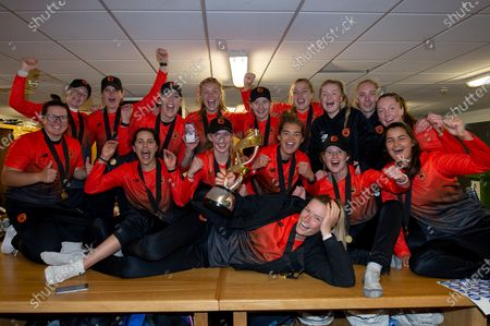 Southern Vipers celebrate in the changing room with the Rachael Heyhoe Flint trophy