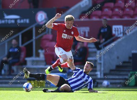 Tom Lees of Sheffield Wednesday fouls Taylor Moore of Bristol City; Ashton Gate Stadium, Bristol, England; English Football League Championship Football, Bristol City versus Sheffield Wednesday.