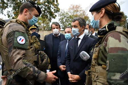 French Interior Minister Gerald Darmanin (C), next to to the President of the Israelite Central Consistory of France Joel Mergui (C background), speaks with a French soldier during a visit at the synagogue of Boulogne-Billancourt, a suburb of Paris, France, 27 September 2020.