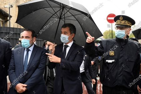 French Interior Minister Gerald Darmanin (C), next to the President of the Israelite Central Consistory of France Joel Mergui (L) and Paris police prefect Didier Lallement (R), arrives for a visit at the synagogue of Boulogne-Billancourt, a suburb of Paris, France, 27 September 2020.