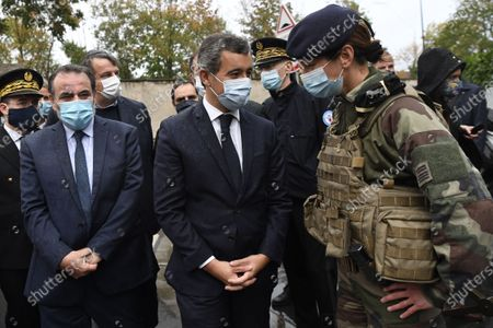 Stock Photo of French Interior Minister Gerald Darmanin (C), next to to the President of the Israelite Central Consistory of France Joel Mergui (L), speaks with a French soldier during a visit at the synagogue of Boulogne-Billancourt, a suburb of Paris, France, 27 September 2020.