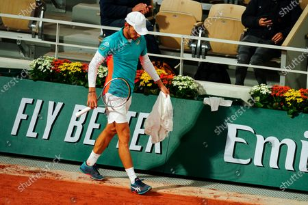 A dejected David Goffin reacts after losing his 2nd set in 28 minutes during his Men's Singles first round match on Philippe Chatrier Court