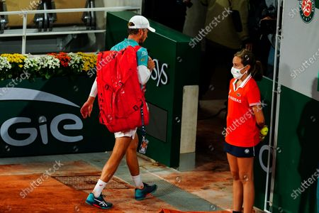 David Goffin leaves after being knocked out in straight sets after his Men's Singles first round match on Philippe Chatrier Court