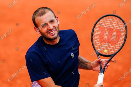 Dan Evans celebrates winning a point during his Men's Singles first round match on Court 14