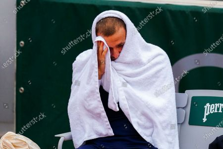 Dan Evans wraps up for warmth during his Men's Singles first round match on Court 14