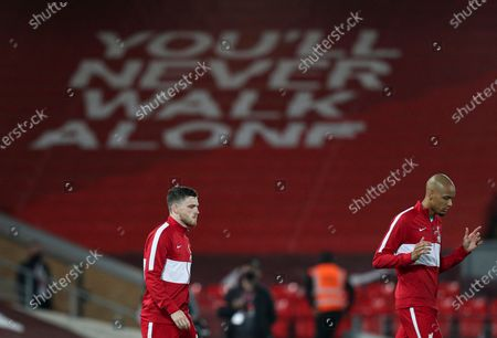Andrew Robertson of Liverpool and Fabinho walk out