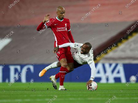 Fabinho of Liverpool challenges Alexandre Lacazette of Arsenal