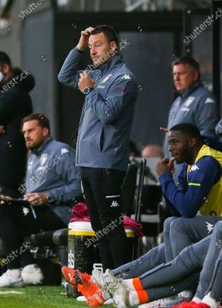 Stock Photo of Aston Villa's assistant head coach John Terry  does his best Stan Laurel head scratch impression