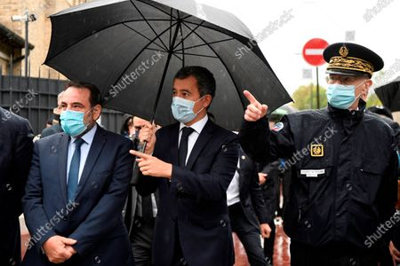 Stock Picture of French Interior Minister Gerald Darmanin, center, Joel Mergui, left, President of the Israelite Central Consistory of France and Paris police prefect Didier Lallement, arrive for a visit at the synagogue of Boulogne-Billancourt, outside Paris, . France's interior minister promised to protect France's Jewish community from extremists after a double stabbing in Paris blamed on Islamic terrorism. France has Europe's largest Jewish community
