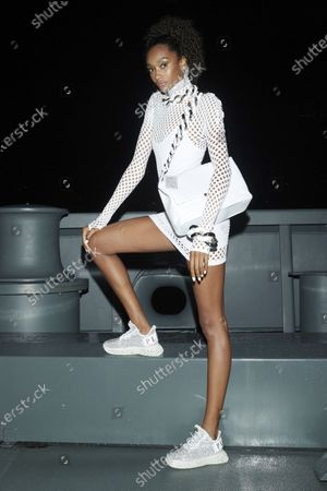 Stock Image of A Model wearing an outfit from the women s ready to wear collections, spring summer 2021, original creation, during the Womenswear Fashion Week in Milan, from the house of Philipp Plein