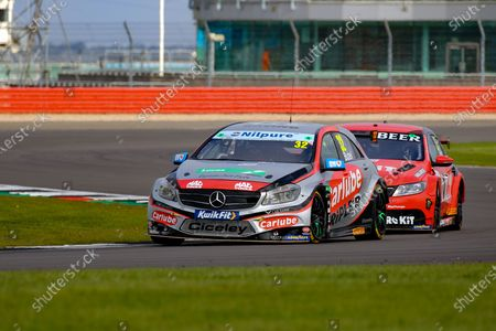 Jack Butel- Carlube TripleR Racing with Cataclean & Mac Tools - Mercedes Benz A -Class battles with `Nicolas Hamilton - ROKIT Racing with Team Hard - Volkswagen CC during the Kwik-Fit BTCC at Silverstone National, Towcester. Picture by Chris Wynne
