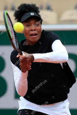 Venus Williams of the U.S. plays a shot against Slovakia's Anna Karolina Schmiedlova in the first round match of the French Open tennis tournament at the Roland Garros stadium in Paris, France