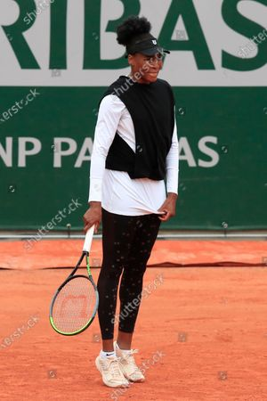 Venus Williams of the U.S. reacts after missing a shot against Slovakia's Anna Karolina Schmiedlova in the first round match of the French Open tennis tournament at the Roland Garros stadium in Paris, France