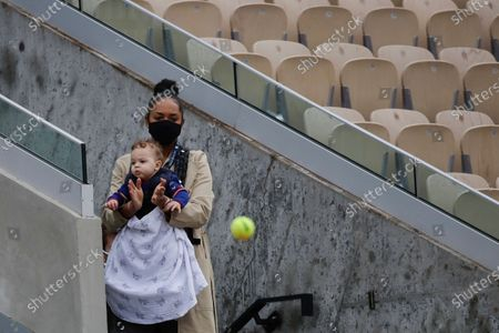 Spectators watch the first round match between France's Jeremy Chardy and Austria's Jurij Rodionov on Suzanne Lenglen court of the French Open tennis tournament at the Roland Garros stadium in Paris, France