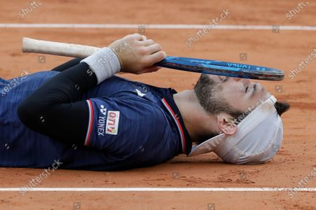 Austria's Jurij Rodionov celebrates his five-set win over France's Jeremy Chardy in the first round match of the French Open tennis tournament at the Roland Garros stadium in Paris, France