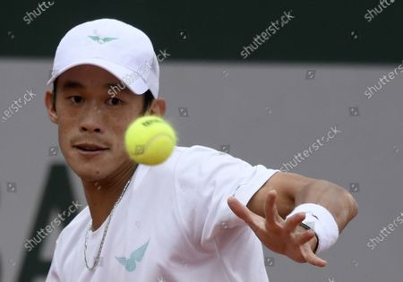 Jason Jung of Taiwan in action against Federico Coria of Argentina during their men's first round match during the French Open tennis tournament at Roland Garros in Paris, France, 27 September 2020.