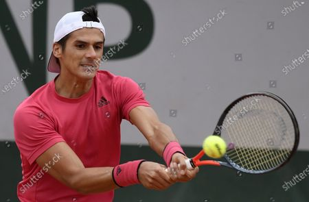 Federico Coria of Argentina in action against Jason Jung of Taiwan during their men's first round match during the French Open tennis tournament at Roland Garros in Paris, France, 27 September 2020.