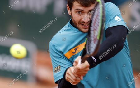 Pedro Martinez of Spain in action against Aleksandar Vukic of Australia during their men's first round match during the French Open tennis tournament at Roland Garros in Paris, France, 28 September 2020.