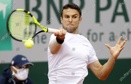 Aleksandar Vukic of Australia in action against Pedro Martinez of Spain during their men's first round match during the French Open tennis tournament at Roland Garros in Paris, France, 28 September 2020.