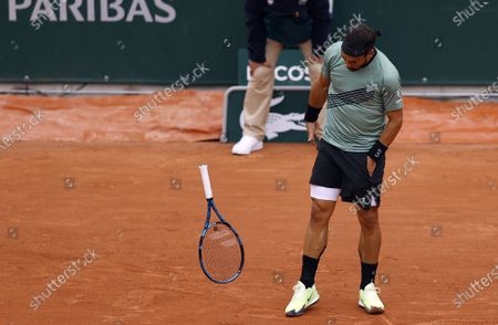 Fabio Fognini of Italy throws his racket as he plays Mikhail Kukushkin of Kazakhstan during their men's first round match during the French Open tennis tournament at Roland Garros in Paris, France, 28 September 2020.