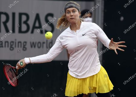Stefanie Voegele of Switzerland in action against Patricia Maria Tig of Romania during their women's first round match during the French Open tennis tournament at Roland Garros in Paris, France, 28 September 2020.