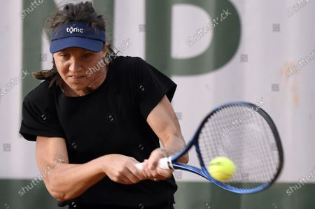 Patricia Maria Tig of Romania in action against Stefanie Voegele of Switzerland during their women's first round match during the French Open tennis tournament at Roland Garros in Paris, France, 28 September 2020.