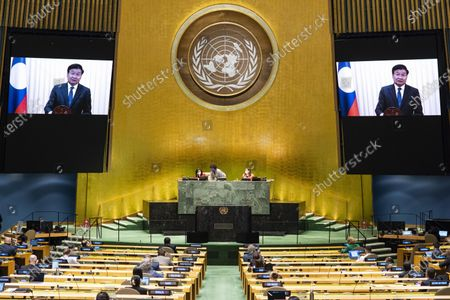 Lao Prime Minister Thongloun Sisoulith (on the screens) addresses the General Debate of the 75th session of the UN General Assembly at the UN headquarters in New York, on Sept. 26, 2020. The General Debate of the 75th session of the UN General Assembly entered the fifth day on Saturday.