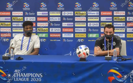 Al Sadd SC head coach Xavi Hernandez (R) and player Musaab Khidr Mohamed attend a press conference ahead of the round of 16 match of AFC Champions League between Persepolis FC of Iran and Al Sadd of Qatar in Doha, capital of Qatar, Sept. 26, 2020.