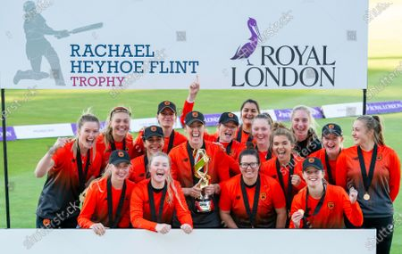The Southern Vipers's with captain Georgia Adams (centre) with the Rachael Heyhoe Flint trophy after victory over the Northern Diamonds.
