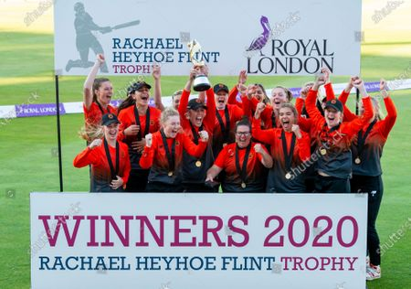Stock Photo of The Southern Vipers's with captain Georgia Adams (centre) raise the Rachael Heyhoe Flint trophy after victory over the Northern Diamonds.
