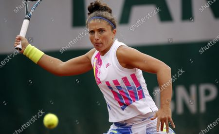 Sara Errani of Italy in action against Monica Puig of Puerto Rico during their women's first round match during the French Open tennis tournament at Roland Garros in Paris, France, 28 September 2020.
