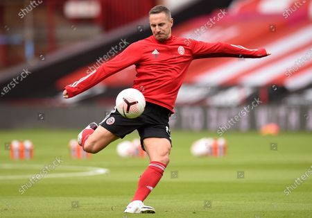 Stock Image of Sheffield United's Phil Jagielka warms up prior the start of the English Premier League soccer match between Sheffield United and Leeds United at Bramall Lane stadium in Sheffield, England