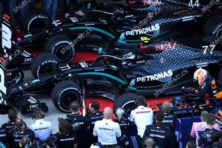 Drivers arrive in the winners circle after the Russian Formula One Grand Prix, at the Sochi Autodrom circuit, in Sochi, Russia, . Drivers from left, Mercedes driver Lewis Hamilton of Britain, third place, Mercedes driver Valtteri Bottas of Finland, first place, and Red Bull driver Max Verstappen of the Netherlands, second place