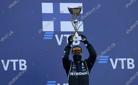 Mercedes driver Valtteri Bottas of Finland celebrates on the podium after winning the Russian Formula One Grand Prix, at the Sochi Autodrom circuit, in Sochi, Russia